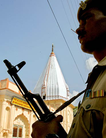 A policeman stands guard outside a temple in Ayodhya