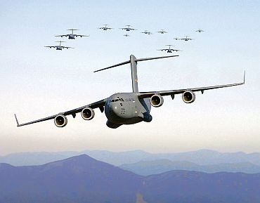 C-17 Globemaster III aircraft fly over the Blue Ridge Mountains in Virginia during low level tactical training