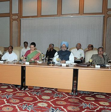 Dr Singh is flanked by Congress chief Sonia Gandhi and Defence minister AK Antony (on the left) and Finance Minister Pranab Mukherjee (on the right)