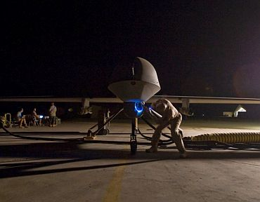 A drone undergoes maintainence procedure at a US base in Afghanistan