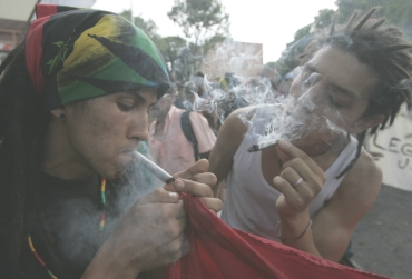 Protesters smoke marijuana during a demonstration in Medellin, Colombia