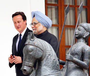 British Prime Minister David Cameron with his Indian counterpart Manmohan Singh