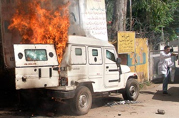 A burning armoured police vehicle after it was set on fire by demonstrators