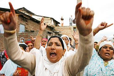 Women shout anti-India slogans during an anti-India protest in Srinagar