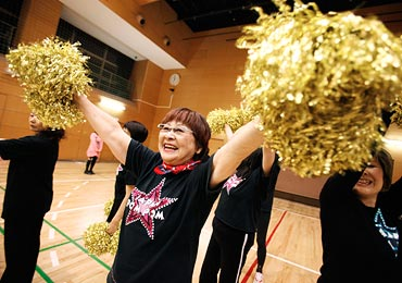 Fumie Takino, a 78-year-old cheerleader, practices cheerleading in Tokyo