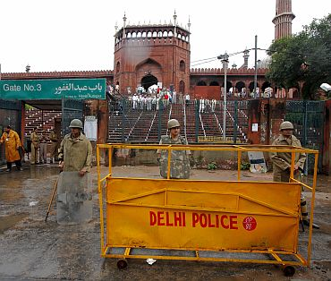 Police stand guard outside Jama Masjid after the shooting incident