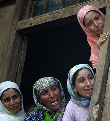 Relatives of a victim of police firing at his funeral in Kashmir