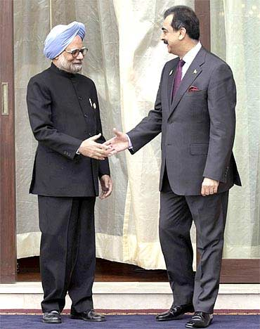 Prime Minister Manmohan Singh with Pakistan Prime Minister Yusuf Raza Gilani at the 16th summit of the SAARC in Thimphu