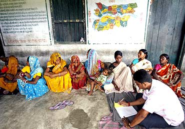 Pregnant women register their names as they wait for medical assistance in Araria district, Bihar