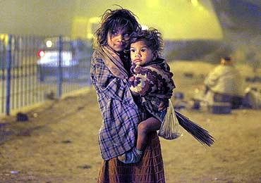 Homeless children under a flyover in New Delhi