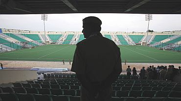 A policeman stands guard at the Major Dhyan Chand National Stadium in New Delhi