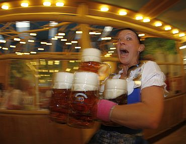 A waitress serves beer during the opening day of the 177th Oktoberfest in Munich