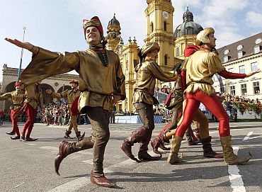 People in traditional costumes march during the Oktoberfest parade in Munich