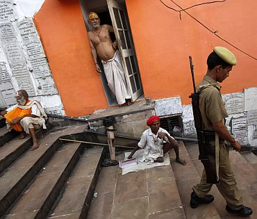 A policeman patrols outside a temple in Ayodhya