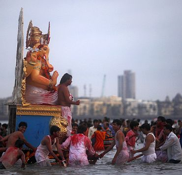 Devotees carry an idol of Ganesh, the deity of prosperity, for immersion in the sea on the last day of Ganesh Chaturthi, in Mumbai