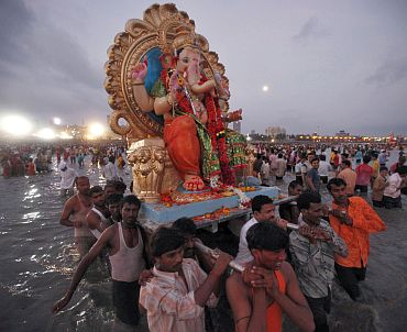 Devotees carry an idol of Ganesh, the deity of prosperity, for immersion in the sea