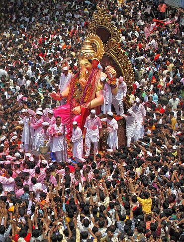 Devotees carry a Ganesh idol to immerse it in the waters of the Arabian Sea