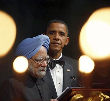 Obama listens to Prime Minister Manmohan Singh's address at the White House last November