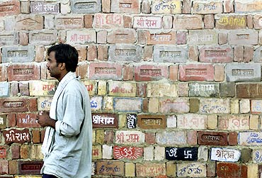 A man walks past a temple wall in Ayodhya