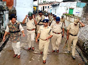 Superintendent of Police, Ratlam, Mayank Jain, forefront, leads a search operation, September 4