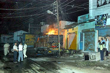 Mediapersons at the site where a truck was torched in Danipura, September 3
