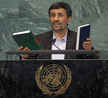 Ahmadinejad holds up copies of the Koran and the Bible while addressing the 65th United Nations General Assembly