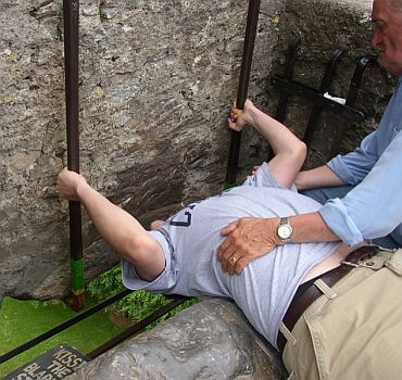 A man kisses the Blarney Stone