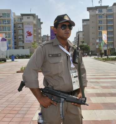 A security personnel at the Games Village