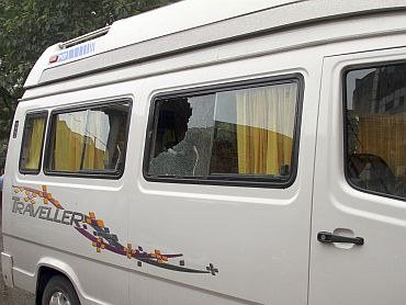 The vehicle, which local media say Taiwanese tourists were travelling, is seen near the shooting spot