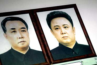 Portraits of North Korea's founder and Kim Il-sung (L) and his son and current leader Kim Jong-il are hung at an observation post in Seoul