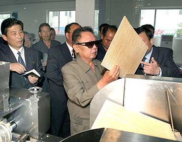 North Korean leader Kim Jong-il visits the Pyongyang Cornstarch Factory in this undated picture