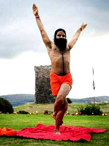 Baba Ramdev performs yoga.
