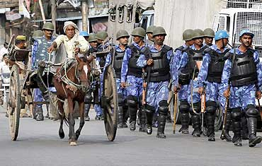 Security personnel patrol the streets of Ayodhya