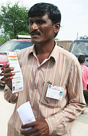 Mali Devidas Bhairas shows his card