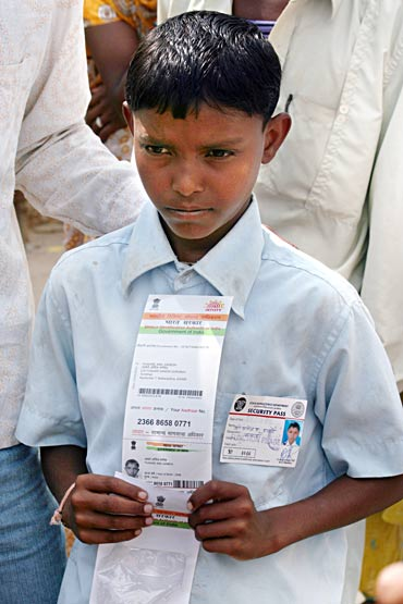 Thakare Anil Ganesh shows his UID
