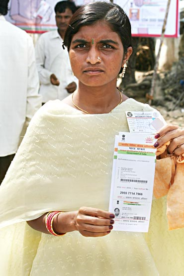 Mali Bhuri Rohidas shows her card