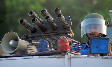 A Rapid Action Force trooper keeps guard atop his armoured vehicle in Allahabad