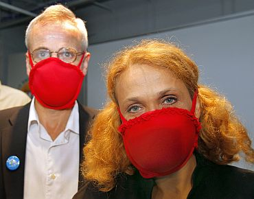 (R-L) Dr Elena Bodnar and John Durant, Director of the MIT Museum, demonstrate bras being worn as facemasks, at the MIT Museum in Cambridge, Massachusetts