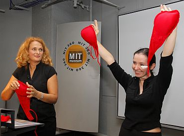 Dr Elena Bodnar watches as a volunteer holds up an 'Emergency Bra' after taking it off at the MIT Museum in Cambridge, Massachusetts