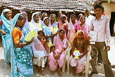 Vasanti Pawar (seated extreme right) and other villagers in Tembhali village