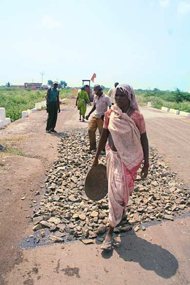 Govt's dual-strategy: Pave the road plus give work to labourers as part of the NREGA