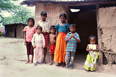Village kids in front of their huts