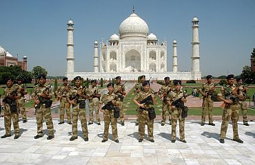 Paramilitary troopers stand guard at the Taj Mahal, September 29