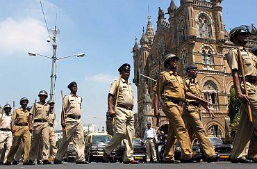 Policemen at Mumbai's Chhatrapati Shivaji Terminus, September 29
