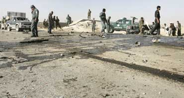 Police investigate a suicide blast site which killed the deputy governor of Afghanistan's Ghazni province