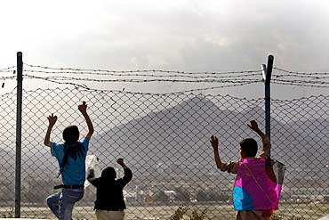 A boy and his friends look at a view in Kabul