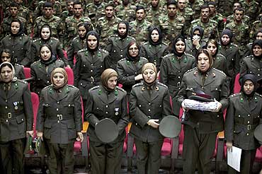Newly graduated soldiers from the Afghan National Army attend a graduation ceremony in Kabul