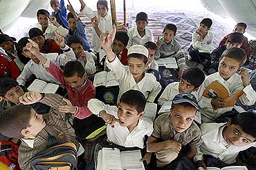 Afghan students study in a make-shift classroom