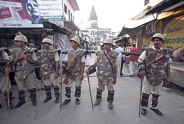 Paramilitary troopers stand guard in Ayodhya