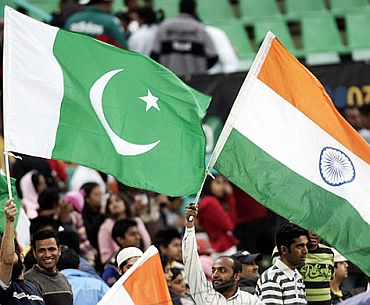 Fans cheer on India and Pakistan teams